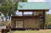 Дом из контейнеров на берегу озера.